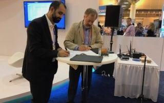 MoU signing paperwork at WEFTEC