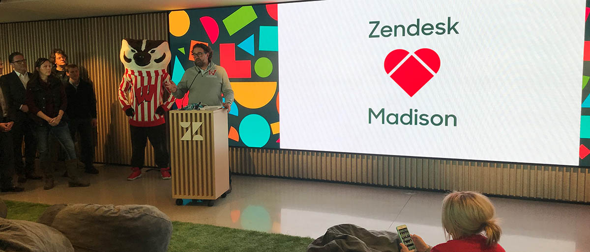 A representative of Zendesk addresses staff at an event