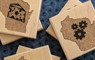 Coasters designed by Wisconsin high schools in the Fab Lab