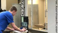 A student prepares the PCNC 770 small mill in the fab lab at Phillips High School