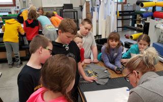 Students learn how to weed heat press material at the Warrior Innovation Center in Waupun