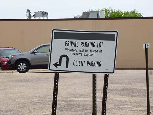 Signage at a private parking lot in New Ulm