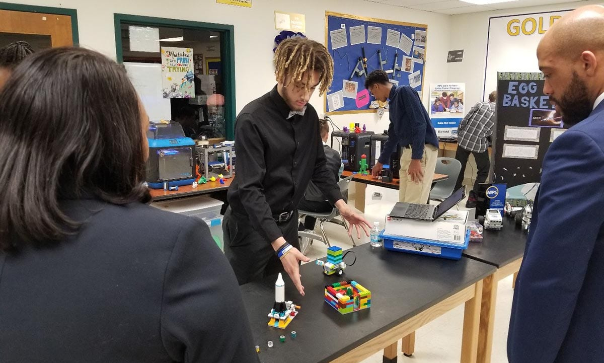 Wisconsin Lt. Gov. Mandela Barnes watches a student demonstrate a robotics project in a fab lab